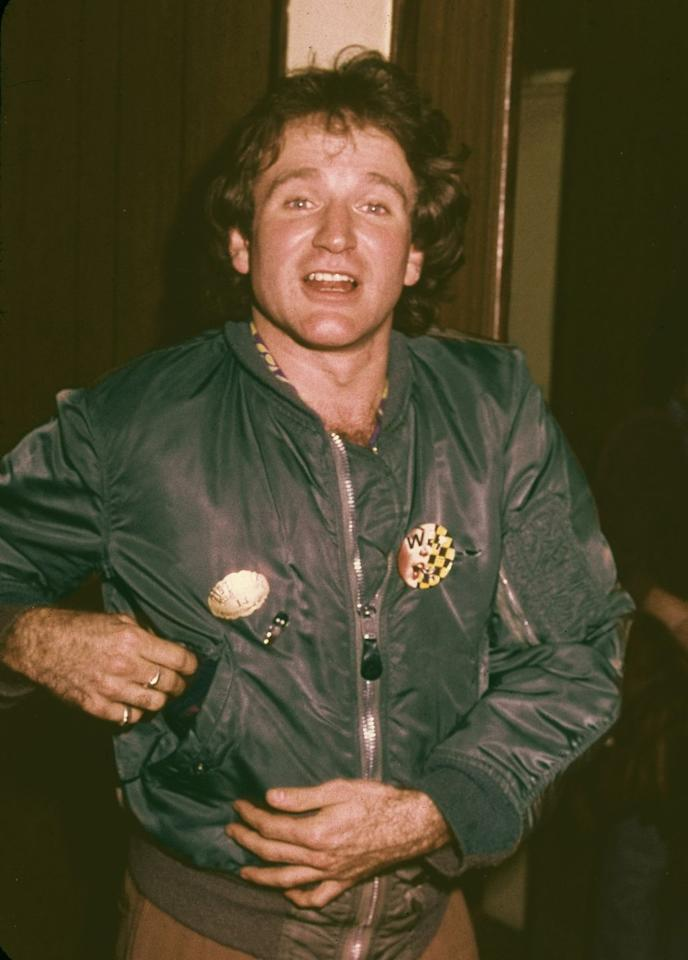 <p>Robin Williams, in a silk bomber jacket, arrives at Beverly Hills High School for a celebrity basketball game in March 1979.</p>
