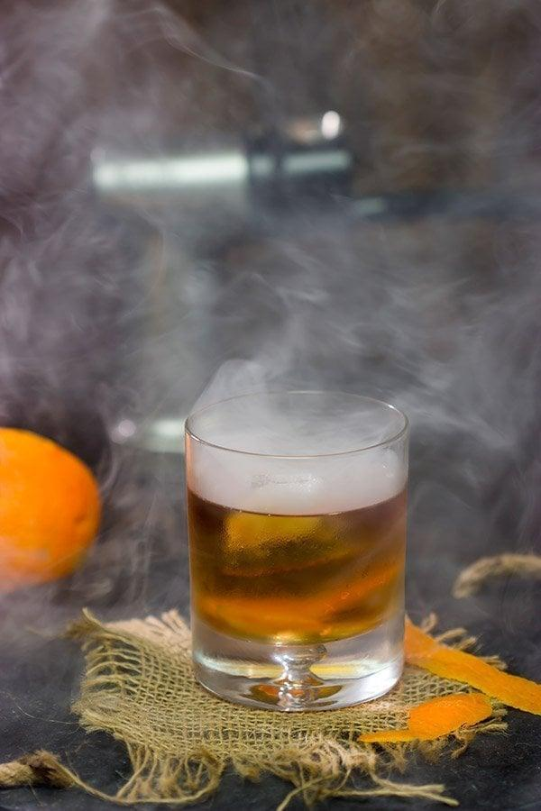 """<p>A classic bourbon cocktail, the old fashioned is about as cool as it gets. Stiff, chilled, and strong, DC knows what a good drink tastes like. Try making a smoked old fashioned if you really want to elevate your happy hour experience. </p> <p><strong>Get the recipe</strong>: <a href=""""https://www.popsugar.com/buy?url=https%3A%2F%2Fspicedblog.com%2Fsmoked-old-fashioned.html&p_name=smoked%20old%20fashioned&retailer=spicedblog.com&evar1=yum%3Aus&evar9=47471653&evar98=https%3A%2F%2Fwww.popsugar.com%2Ffood%2Fphoto-gallery%2F47471653%2Fimage%2F47473931%2FWashington-DC-Old-Fashioned&list1=cocktails%2Cdrinks%2Calcohol%2Crecipes&prop13=api&pdata=1"""" class=""""link rapid-noclick-resp"""" rel=""""nofollow noopener"""" target=""""_blank"""" data-ylk=""""slk:smoked old fashioned"""">smoked old fashioned</a></p>"""