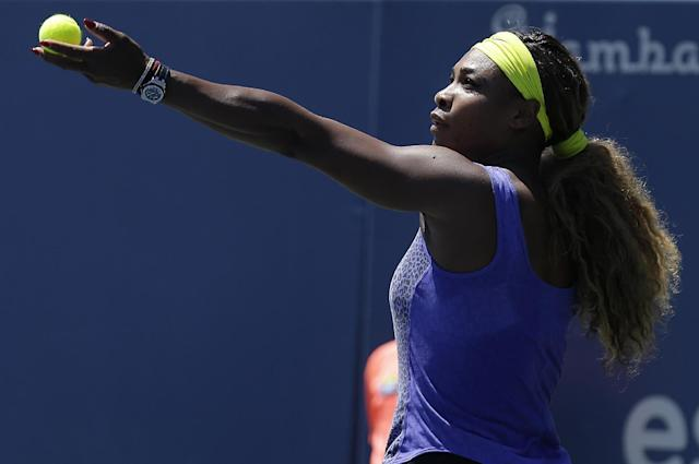 Serena Williams serves to Andrea Petkovic, from Germany, during the first set of their semifinal in the Bank of the West Classic tennis tournament in Stanford, Calif., Saturday, Aug. 2, 2014. (AP Photo/Jeff Chiu)