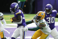 Minnesota Vikings running back Dalvin Cook scores on a 1-yard touchdown run ahead of Green Bay Packers outside linebacker Christian Kirksey (58) during the first half of an NFL football game, Sunday, Sept. 13, 2020, in Minneapolis. (AP Photo/Bruce Kluckhohn)