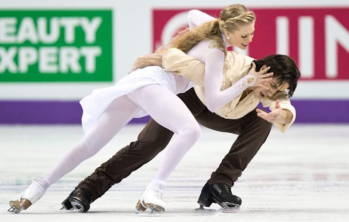 Kaitlyn Weaver and Andrew Poje of Canada perform in the Ice Dance free program at the ISU World Figure Skating Championships in London, Ontario on Saturday, March 16, 2013. (AP Photo/The Canadian Press, Paul Chiasson)