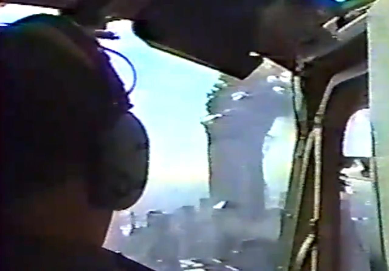 In this image made from New York Police Department video posted on the Internet of the World Trade Center attack, smoke engulfs the twin towers after being hit by commercial airliners, as videotaped from a NYPD helicopter on Sept. 11, 2001. The video was released by the National Institute of Standards and Technology on March 3 under a Freedom of Information Act request, but it wasn't clear who published the footage online.