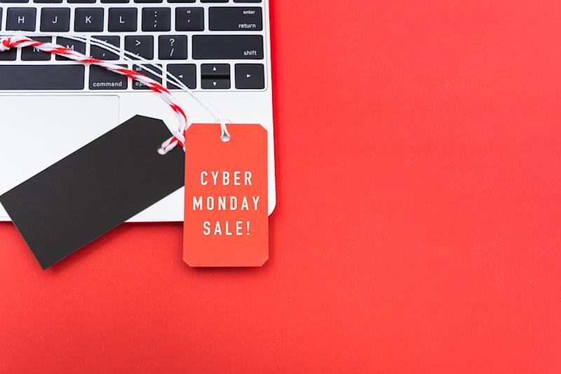 Online shopping Cyber Monday text with red tag label and Blank black red tag on laptop computer, with copy space red background