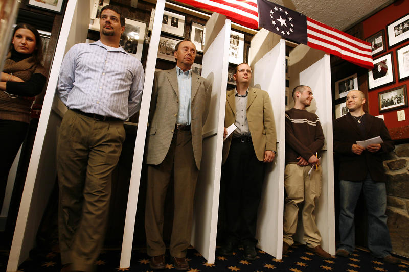 FILE - This Nov. 4, 2008 file photo shows Dixville Notch residents waiting for the stoke of midnight to be the first voters for the nation's presidential election atThe Balsams Grand Resort Hotel in Dixville Notch, N.H. For the first time since the tiny community of Dixville Notch became the first in the nation to cast votes for president in 1960, the stately resort that's hosted the midnight voting will be closed for the Nov. 6 election.    (AP Photo/Cheryl Senter, File)