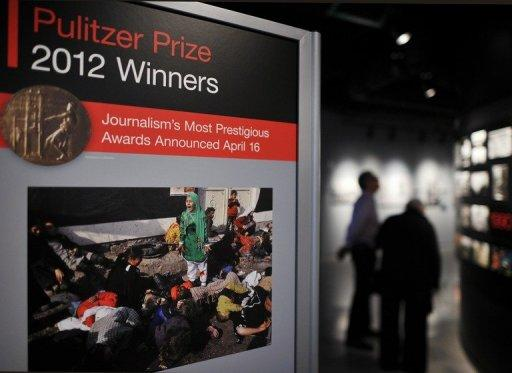 A poster with the 2012 Pulitzer winning photograph by Agence France-Press photographer Massoud Hossaini