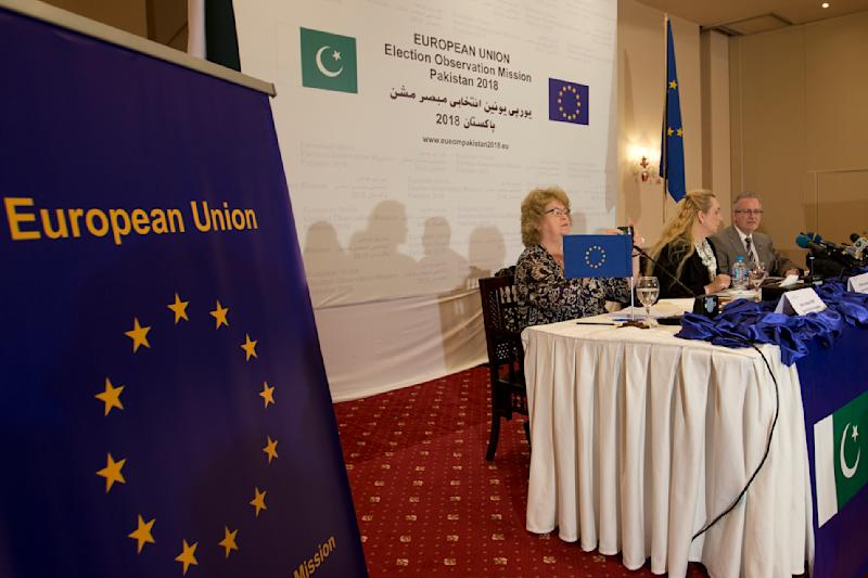Michael Gahler, right, the European Union's monitoring team chief addresses a news conference in Islamabad, Pakistan, Friday, July 27, 2018. The European Union's monitoring team gave a passing grade to election day polling in Pakistan. But it gave a failing grade to the pre-polling campaigning marred by intimidation of the media and unfair targeting of the former ruling party, which it said overshadowed the successes. (AP Photo/B.K. Bangash)