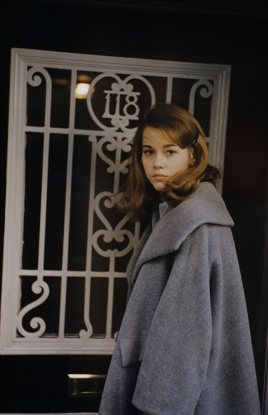 <p>Fonda is pictured standing outside a door in New York City. </p>
