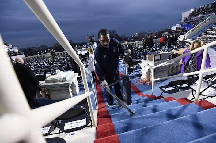 <p>A worker cleans steps on the inaugural stand on Capitol Hill in Washington, Friday, Jan. 20, 2017, before the inauguration of Donald Trump as the 45th president of the United States. (Photo: Saul Loeb via AP, Pool) </p>