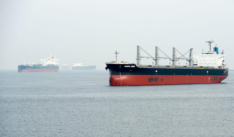 Container ships waiting to pick up cargo at the Los Angeles and Long Beach harbors on December 4, 2012 in Los Angeles, California