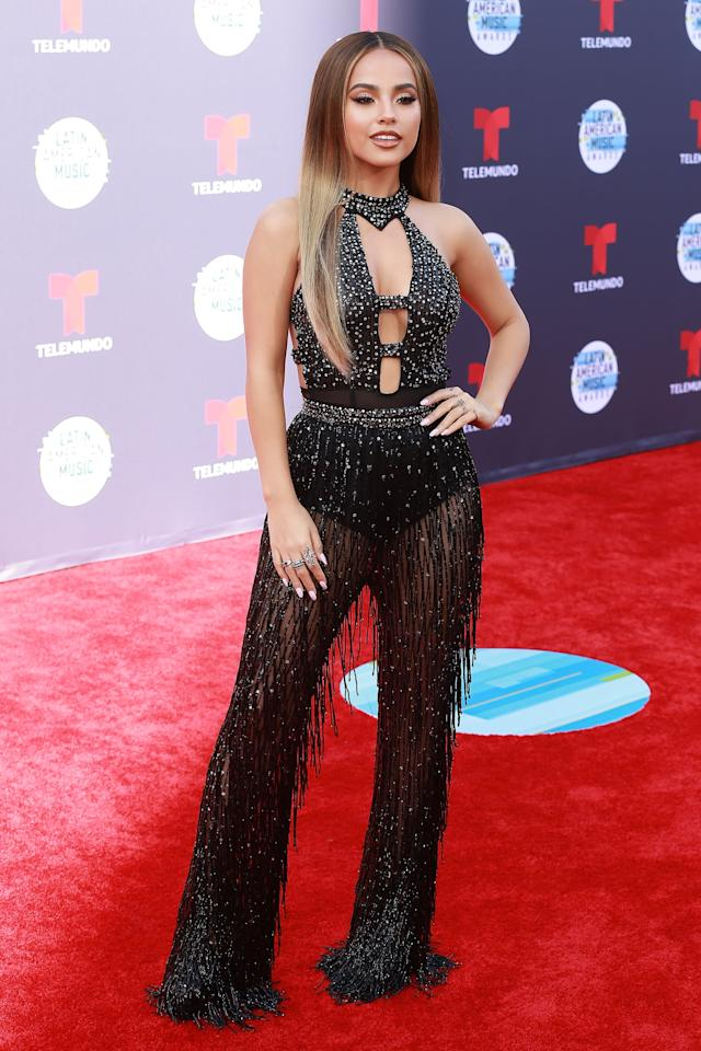 <p>The singer donned a sparkly black jumpsuit for the Latin American Music Awards in LA in October 2018. </p>