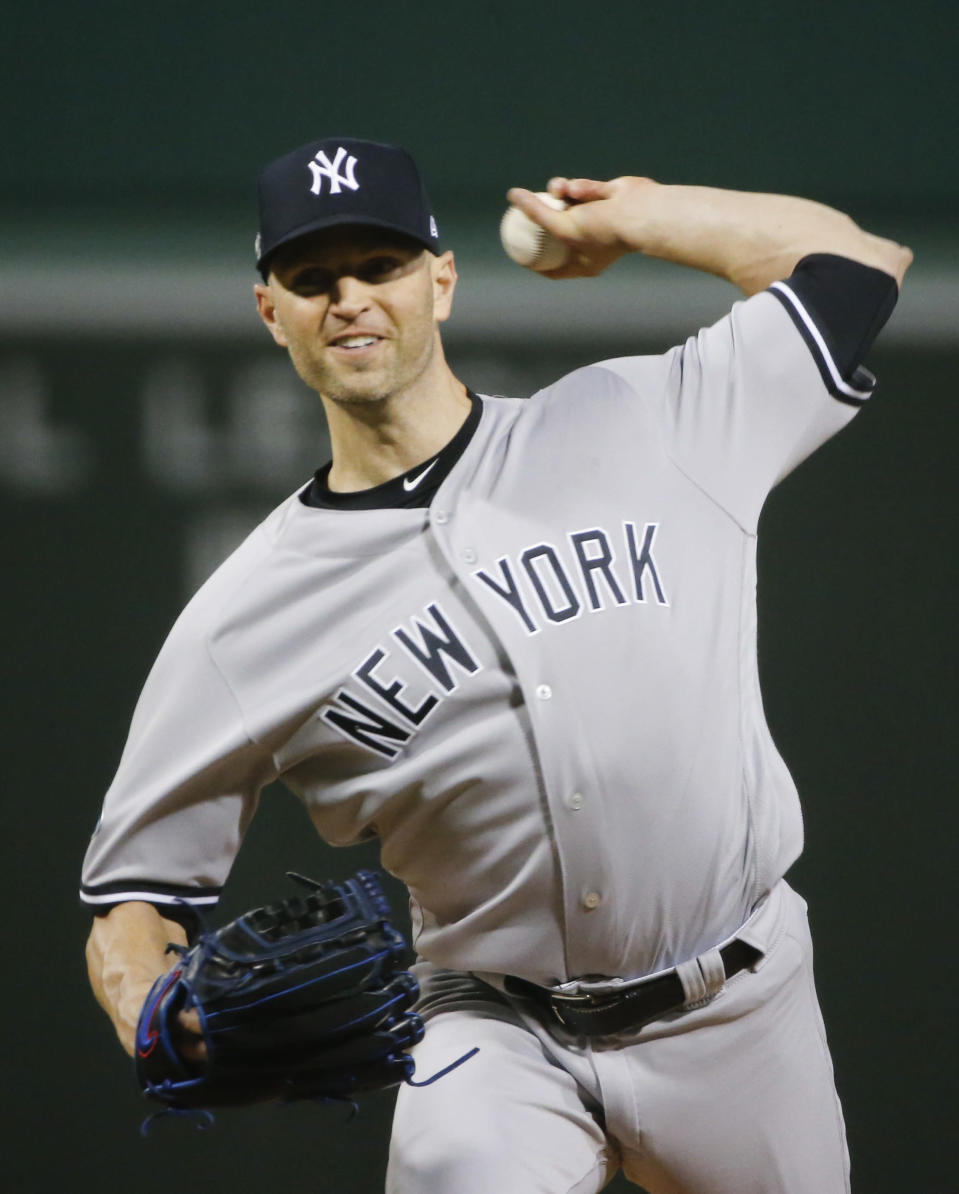 New York Yankees starting pitcher J.A. Happ throws to a Boston Red Sox batter during the first inning of Game 1 of a baseball American League Division Series on Friday, Oct. 5, 2018, in Boston. (AP Photo/Elise Amendola)