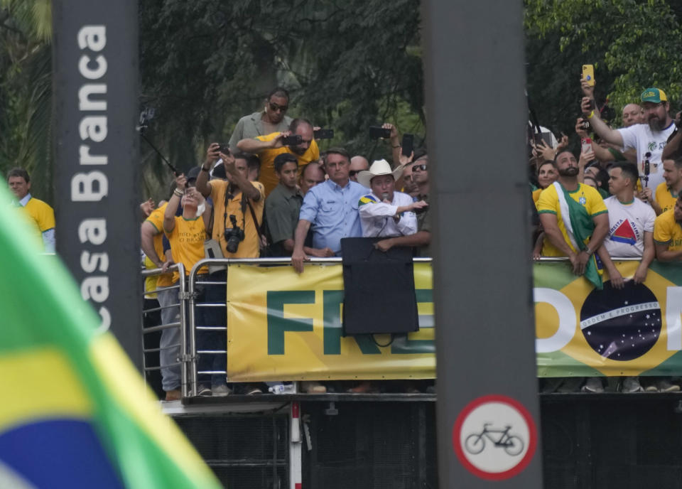 Brazilian President Jair Bolsonaro, center, wearing a blue shirt, attends a rally with thousands of his supporters, on Independence Day in Sao Paulo, Brazil, Tuesday, Sept. 7, 2021. (AP Photo/Andre Penner)