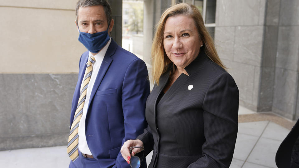 Virginia State Sen. Amanda Chase, R-Chesterfield, right, leaves court with her attorney Tim Anderson during a break in a hearing to dismiss here lawsuit in Federal court in Richmond, Va., Thursday, April 1, 2021. (Steve Helber/AP Photo)
