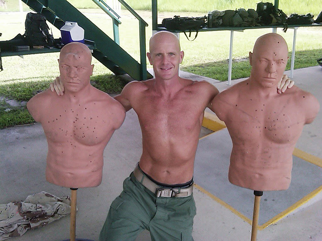 This undated photograph obtained by The Seattle Times shows FBI Special Agent Frederick W. Humphries posing with target dummies following a SWAT practice in an unknown location. The Times says Humphries sent the photograph to friend and Florida socialite Jill Kelley and others, including one of the paper's own reporters, in an email Sept. 9, 2010. (AP Photo/Special to The Seattle Times)