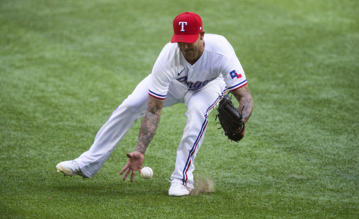 Texas Rangers relief pitcher Matt Bush (51) fields a hit by Toronto Blue Jays' Bo Bichette (11) during the eighth inning of a baseball game, Wednesday, April 7, 2021, in Arlington, Texas. Bush was unable to make the throw to first. (AP Photo/Brandon Wade)