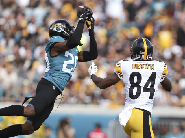 FILE - In this Nov. 18, 2018, file photo, Jacksonville Jaguars cornerback Jalen Ramsey, left, intercepts a pass in front of Pittsburgh Steelers wide receiver Antonio Brown (84) during the first half of an NFL football game in Jacksonville, Fla. Ramsey responded to Tom Coughlins public criticism Friday, April 19, saying the team knows why hes skipping voluntary workouts. Ramsey did not elaborate on the reason for his absence in his Twitter post, but said he will be ready when its time. (AP Photo/Gary McCullough, File)