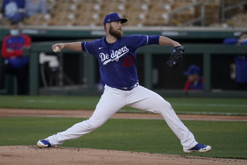 Los Angeles Dodgers pitcher Jimmy Nelson throws to a Chicago Cubs batter during the first inning of a spring training baseball game Thursday, March 4, 2021, in Phoenix. (AP Photo/Ross D. Franklin)