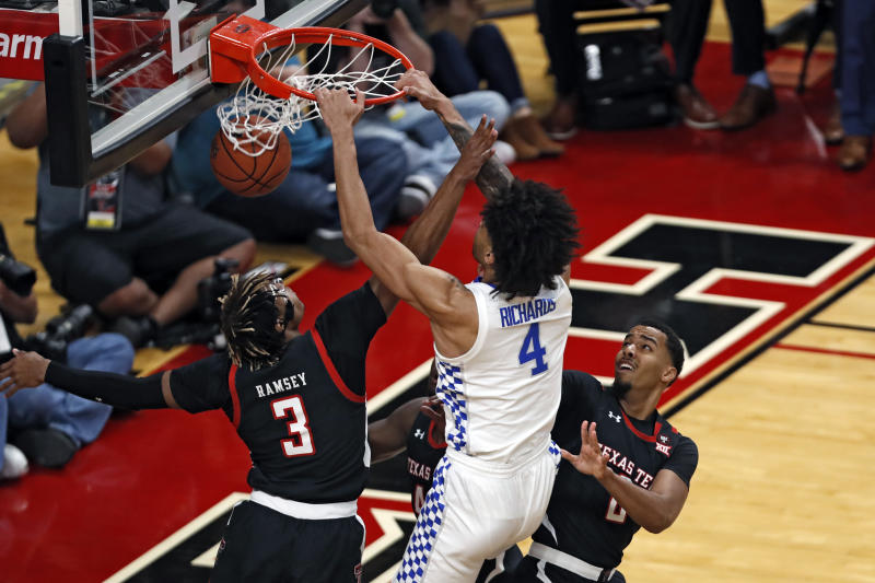 Kentucky's Nick Richards (4) dunks the ball during the first half of an NCAA college basketball game against Texas Tech, Saturday, Jan. 25, 2020, in Lubbock, Texas. (AP Photo/Brad Tollefson)