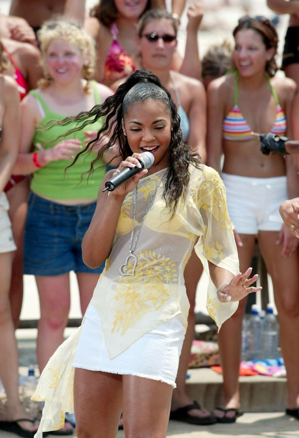 <p>Ashanti performed during MTV All Access Week on <b>TRL</b> at the MTV Beach House in New Jersey in 2002.</p>