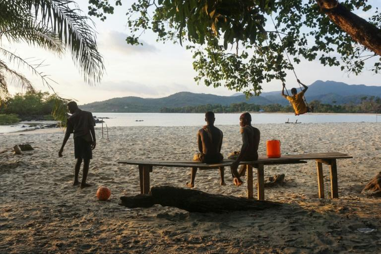 Teenagers on the Black Johnson beach. A tourist attraction 22 miles south of the capital Freetown, Black Johnson village is nestled between stunning black-and-gold beaches and virgin rainforest