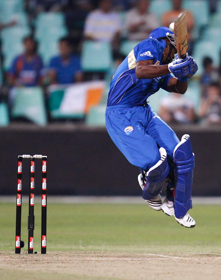 DURBAN, SOUTH AFRICA - SEPTEMBER 14:  Dwayne Bravo of Mumbai Indians in action during the Airtel Champions League Twenty20 match between Mumbai Indians and South Australian Redbacks at Sahara Kingsmead Stadium on September 14, 2010 in Durban, South Africa.  (Photo by Anesh Debiky/Gallo Images/Getty Images)