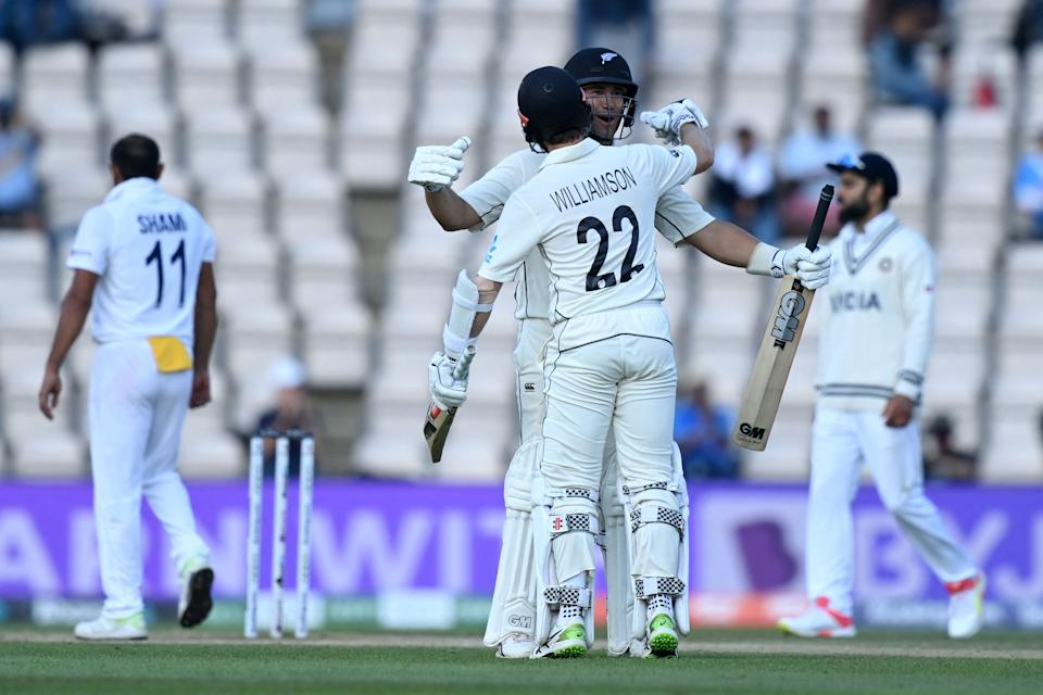 New Zealand's Ross Taylor (R) and New Zealand's captain Kane Williamson celebrate victory on the final day of the ICC World Test Championship Final between New Zealand and India at the Ageas Bowl in Southampton, southwest England on June 23, 2021. - New Zealand beat India by 8 wickets. - RESTRICTED TO EDITORIAL USE (Photo by Glyn KIRK / AFP) / RESTRICTED TO EDITORIAL USE (Photo by GLYN KIRK/AFP via Getty Images)