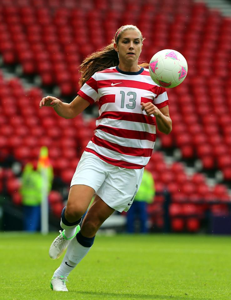 GLASGOW, SCOTLAND - JULY 28:  Alex Morgan of USA controls the ball during the Women's Football first round Group G match between United States and Colombia on Day 1 of the London 2012 Olympic Games at Hampden Park on July 28, 2012 in Glasgow, Scotland.  (Photo by Stanley Chou/Getty Images)