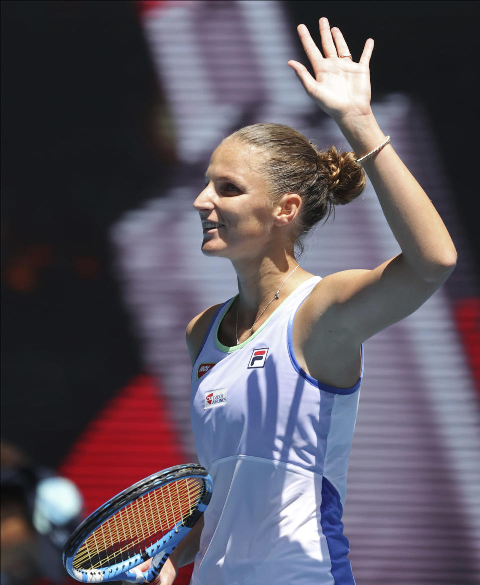 Karolina Pliskova of the Czech Republic waves after defeating France's Kristina Mladenovic in their first round singles match at the Australian Open tennis championship in Melbourne, Australia, Tuesday, Jan. 21, 2020. (AP Photo/Lee Jin-man)