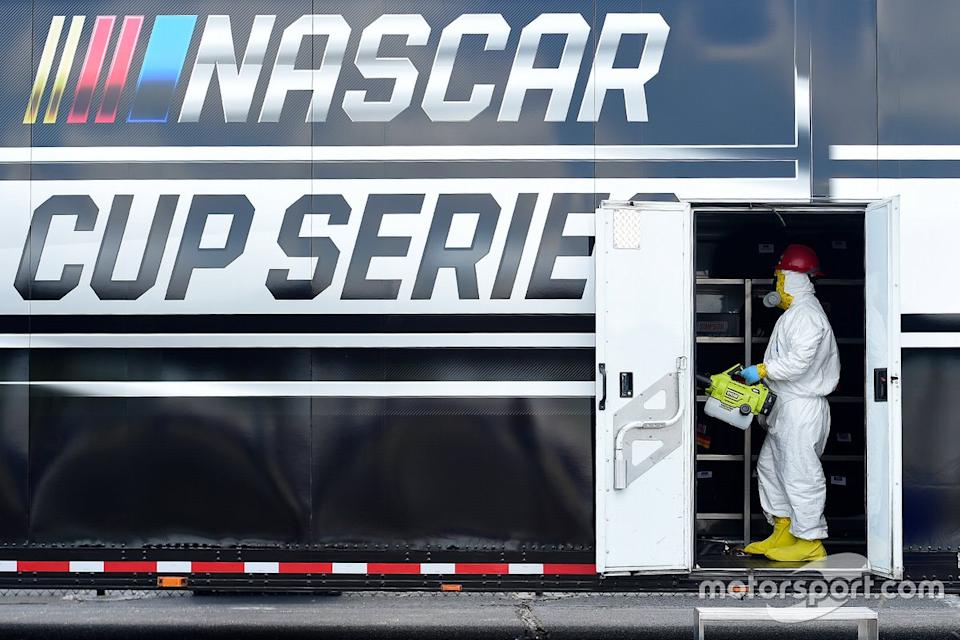 """A worker cleans areas<span class=""""copyright"""">NASCAR Media</span>"""