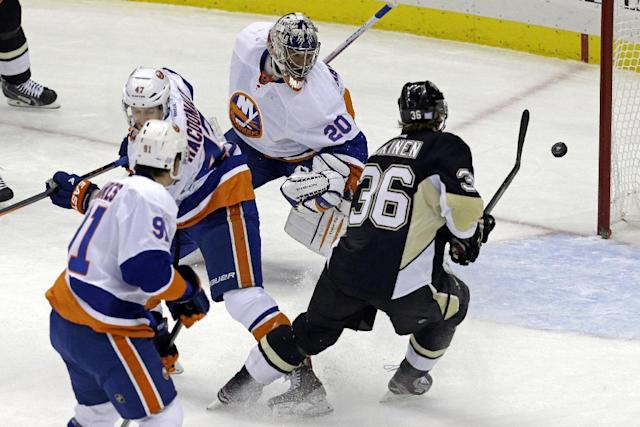 Pittsburgh Penguins' Jussi Jokinen (36) shoots and scores after collecting a rebound off New York Islanders goalie Evgeni Nabokov (20) in the first period of an NHL hockey game in Pittsburgh Friday, Oct. 25, 2013. (AP Photo/Gene J. Puskar)