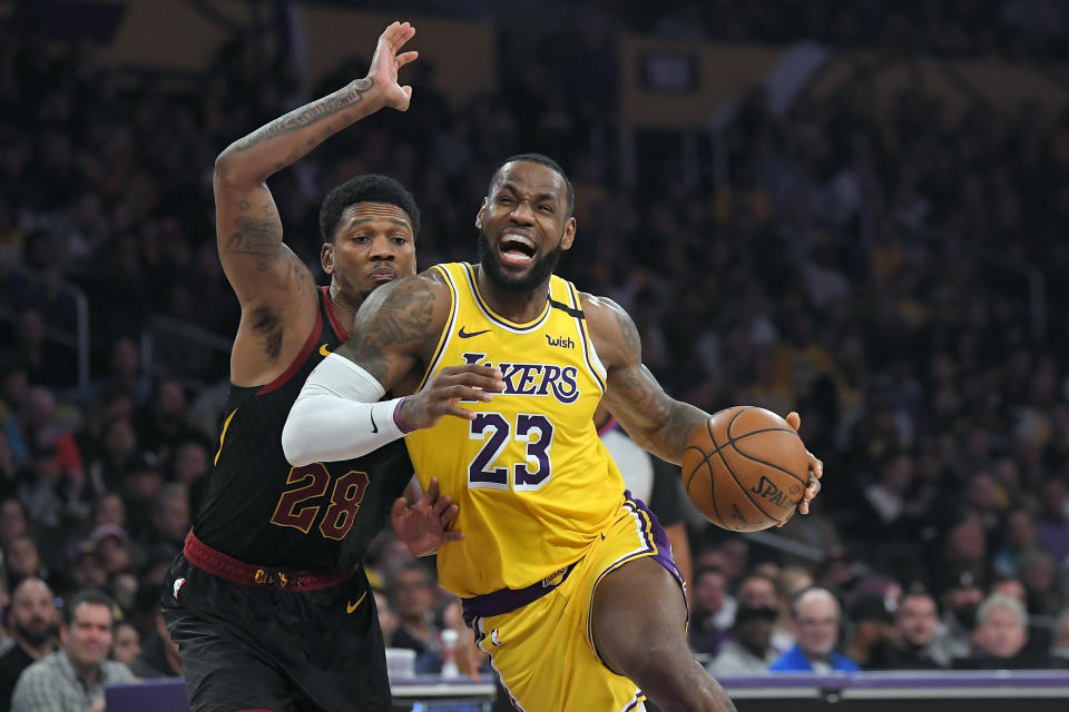 Los Angeles Lakers forward LeBron James, right, drives toward the basket as Cleveland Cavaliers forward Alfonzo McKinnie defends during the second half of an NBA basketball game, Monday, Jan. 13, 2020, in Los Angeles. The Lakers won 128-99. (AP Photo/Mark J. Terrill)