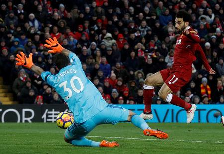 Liverpool's Mohamed Salah scores their second goal.     Action Images via Reuters/Lee Smith