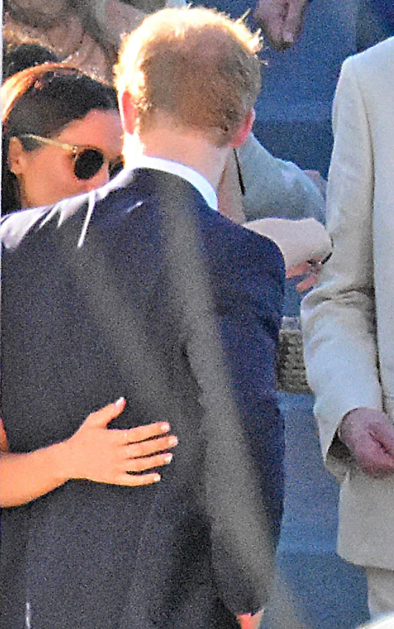 In an intimate moment, Miss Markle was seen with her arm around the Prince - Credit: MEGA