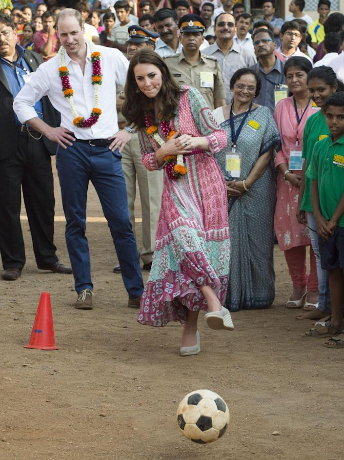 """<p>While not exactly wearing proper sporting attire, Kate did not hesitate to join a soccer game on her <a href=""""https://www.townandcountrymag.com/style/fashion-trends/g2187/kate-middleton-india-bhutan-royal-visit/"""" rel=""""nofollow noopener"""" target=""""_blank"""" data-ylk=""""slk:royal visit to India"""" class=""""link rapid-noclick-resp"""">royal visit to India</a>.</p>"""