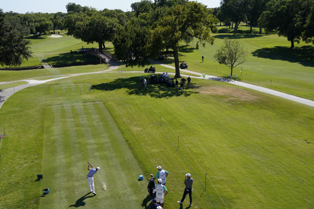 Justin Thomas tees off on the 17th hole during the first round of the Charles Schwab Challenge golf tournament at the Colonial Country Club in Fort Worth, Texas, Thursday, June 11, 2020. (AP Photo/David J. Phillip)