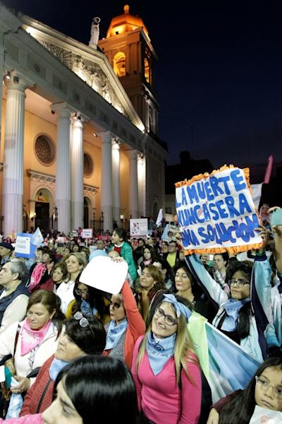 Demonstrators march against efforts to legalize abortion, outside Tucuman Cathedral in northern Argentina in June 2018