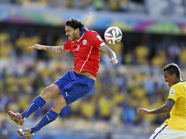 Chile's Mauricio Pinilla heads the ball during the World Cup round of 16 soccer match between Brazil and Chile at the Mineirao Stadium in Belo Horizonte, Brazil, Saturday, June 28, 2014. (AP Photo/Frank Augstein)