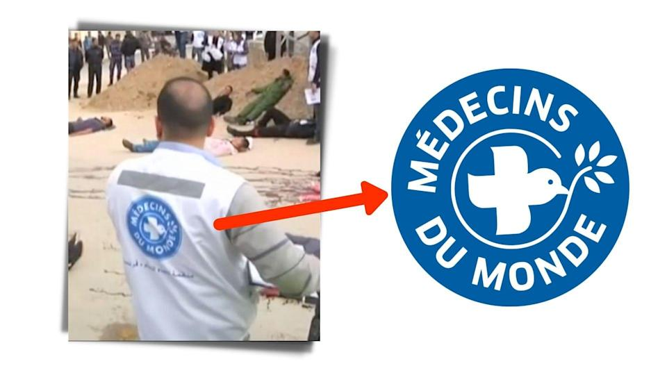 """<div class=""""paragraphs""""><p>The logo for French Charity <em>Médecins du Monde </em>or Doctors of the World is seen on people's backs.</p></div>"""