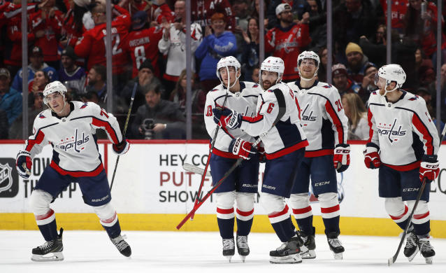 Washington Capitals right wing T.J. Oshie, left, skates away as left wing Jakub Vrana, defenseman Michal Kempny, center Lars Eller and defenseman Nick Jensen, from second from left, celebrate after Oshie scored the go-ahead goal against the Colorado Avalanche during the third period of an NHL hockey game Thursday, Feb. 13, 2020, in Denver. Jensen and Eller had assists on the goal. The Capitals won 3-2. (AP Photo/David Zalubowski)