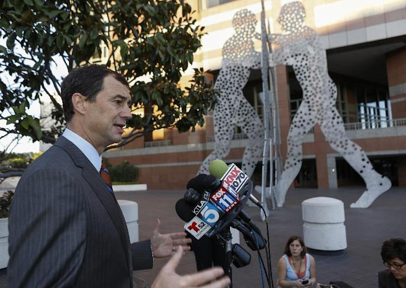Shepard Koop, the attorney for Tom Calderon, takes question outside Los Angeles Federal court in Los Angeles Friday, Feb. 21, 2014. Calderon, a former lawmaker charged in a corruption probe along with his state senator brother, has pleaded not guilty in a Los Angeles court. (AP Photo/Damian Dovarganes)