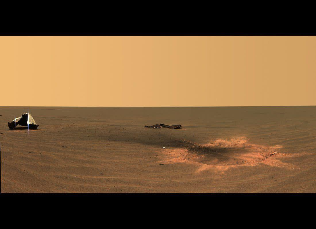 """Postcard of the crater created after the Opportunity rover's heat shield was jettisoned during the January 24, 2004 landing. This is the youngest (known) impact crater on Mars. <em>Opportunity Pancam mosaic, mission sol 330 (December 28, 2004). From """"Postcards from Mars"""" by Jim Bell; Photo credit: NASA/JPL/Cornell University </em>"""