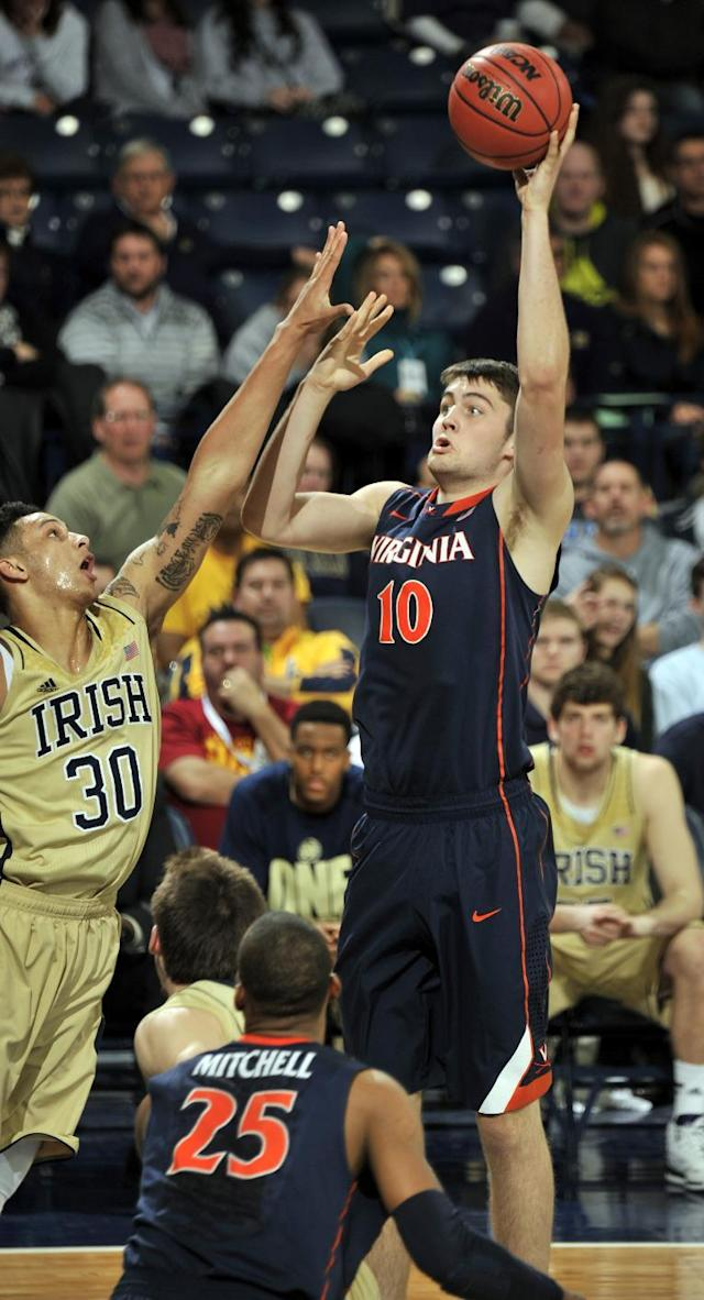 Virginia center Mike Tobey, right, puts a shot up over Notre Dame forward Zach Auguste during the first half of an NCAA college basketball game, Tuesday, Jan. 28, 2014 in South Bend, Ind. (AP Photo/Joe Raymond)