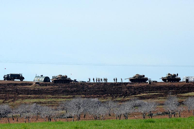Turkish Army vehicles and tanks pictured near the Syrian border in Suruc on February 23, 2015