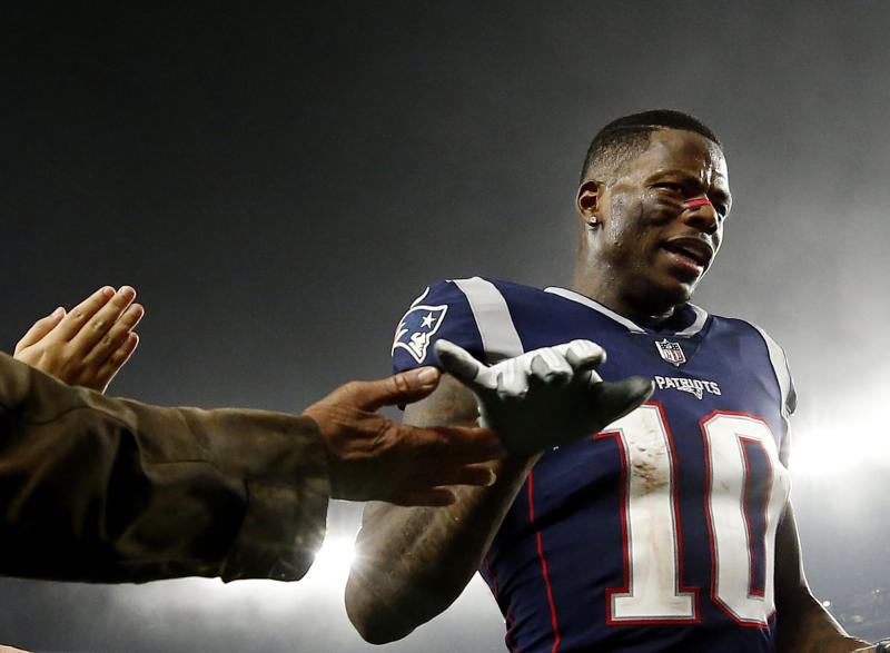 Wide receiver Josh Gordon, suspended in late December by the NFL, congratulated his Patriots teammates on winning the AFC. (AP)