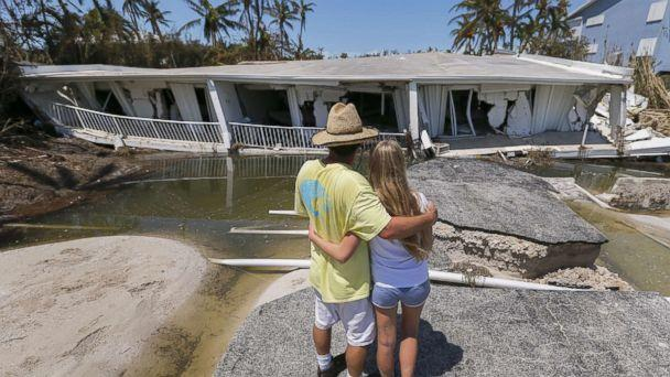 PHOTO: Mike Gilbert hugs his daughter Brooke while looking at a destroyed three-story condominium building after Hurricane Irma struck the Florida Keys in Islamorada, Fla., Sept. 12, 2017. The Gilbert family owns a unit in the building. (Erik S. Lesser/EPA)
