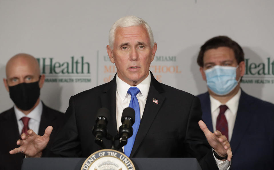 Vice President Mike Pence, with Food and Drug Administration Commissioner Dr. Stephen Hahn, left, and Florida Gov. Ron DeSantis. (Wilfredo Lee/AP)