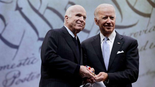 PHOTO: Sen. John McCain receives the Liberty Medal from Chair of the National Constitution Center's Board of Trustees, former Vice President Joe Biden, Oct. 16, 2017, in Philadelphia. (Matt Rourke/AP, FILE)