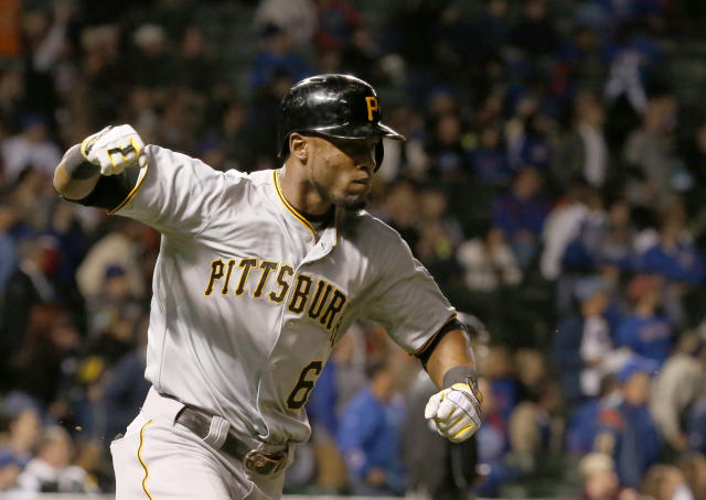 Pittsburgh Pirates' Starling Marte celebrates his home run off Chicago Cubs relief pitcher Kevin Gregg during the ninth inning of a baseball game Monday, Sept. 23, 2013, in Chicago. The home run gave the Pirates a 2-1 lead. (AP Photo/Charles Rex Arbogast)