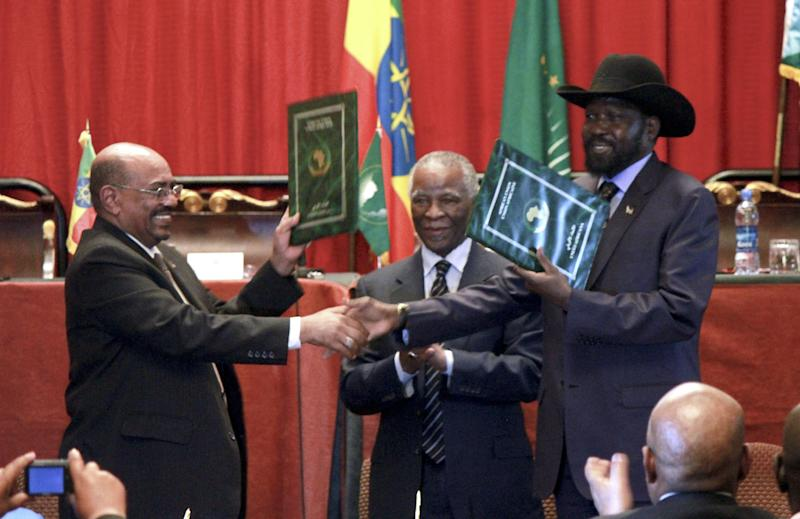 Sudan's President Omar al-Bashir, left, and South Sudan President Salva Kiir, right, shake hands on the completion of a signing ceremony after the two countries reached a deal on economic and security agreements Thursday, Sept. 27, 2012 in Addis Ababa, Ethiopia. The presidents of Sudan and South Sudan signed agreements Thursday that will allow a resumption of oil exports from South Sudan, a demilitarized zone between their borders, and a cessation of all hostilities that brought the countries to the brink of all-out war just a few months ago. (AP Photo/Elias Asmare)