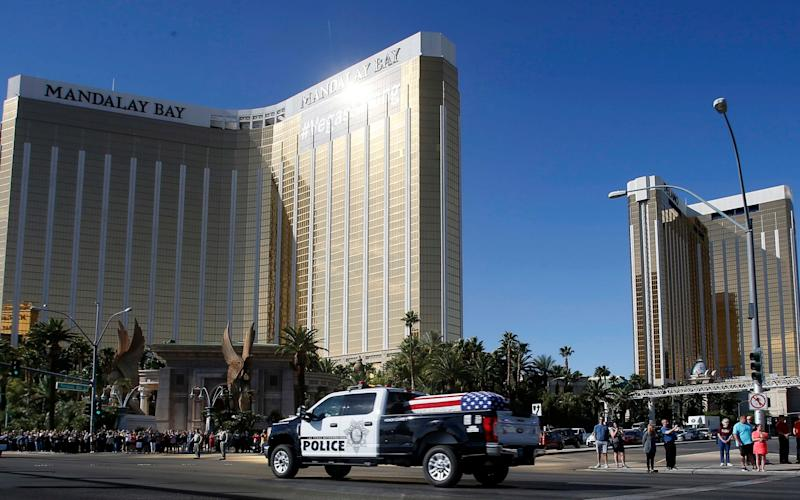 The funeral procession for Las Vegas police officer Charleston Hartfield passes the Mandalay Bay hotel - FR159466 AP